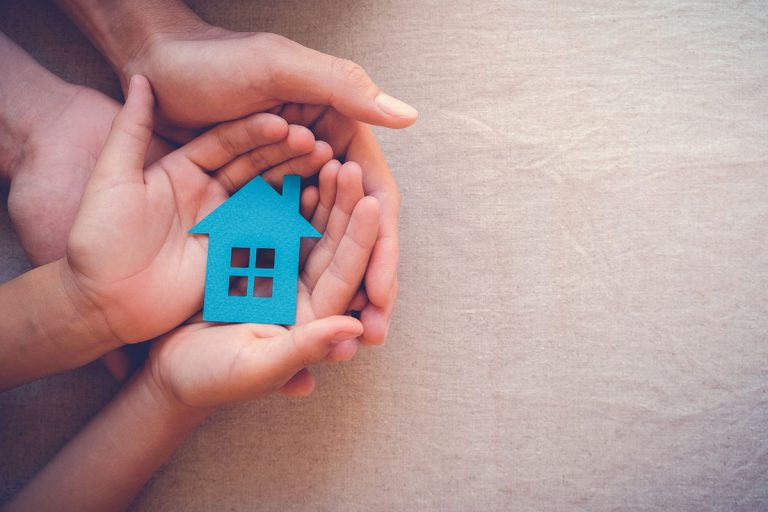 Hands holding a blue paper house, is it time to remortgage?